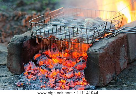 Chicken Meat Baked In The Fire On The Grill Grate