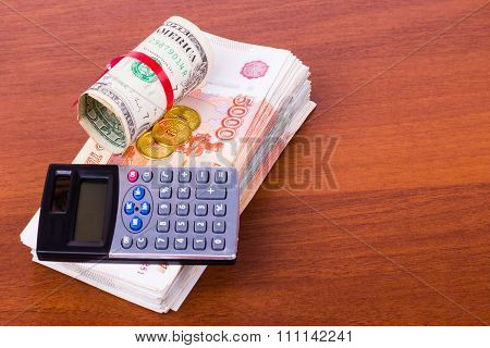 The calculator lies on a big wad of money
