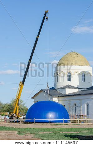 Crane Lifts The Dome Of The Reconstructed Church Of The Kazan Mother Of God In The Village Solodniki