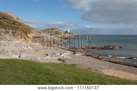 Bracelet Bay and Mumbles lighthouse