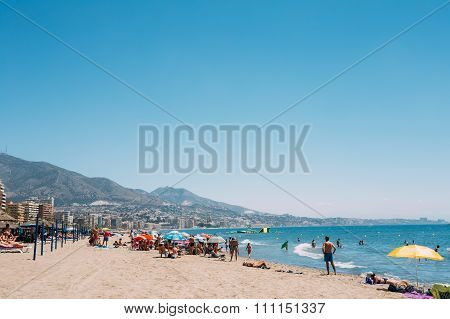 People resting at beach in  Costa del Sol in Fuengirola, Spain.