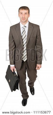 Businessman looking at camera on white