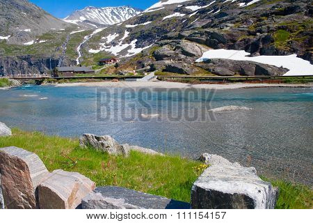 Norway. Mountains And The River Formed By The Thawing Glacier In The Sunny Summer Day