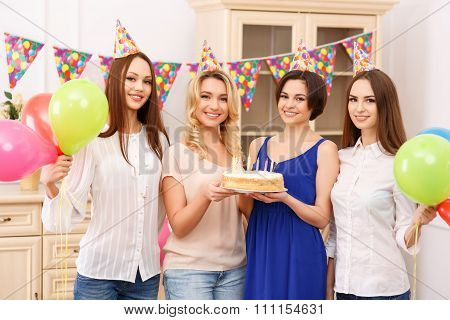 Girls having a birthday party.