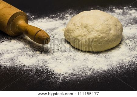 Homemade Pizza Dough With Rolling Pin On The Wooden Table