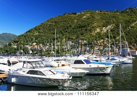 COMO HARBOUR, ITALY, 20 SEPTEMBER, 2015 - Boats in the harbour of Como, italy, Lombardy, Europe
