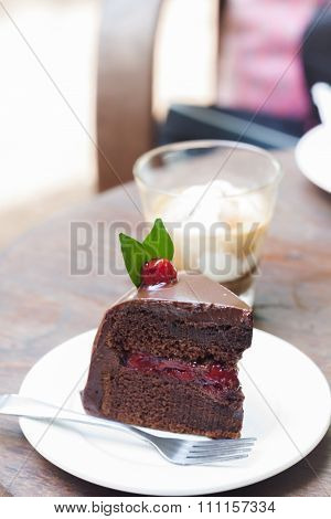 Piece Of Chocolate Cake On White Plate