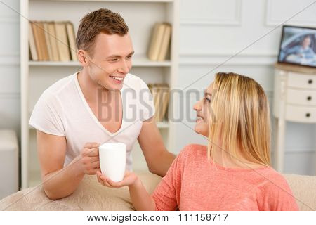Young smiling couple at home.
