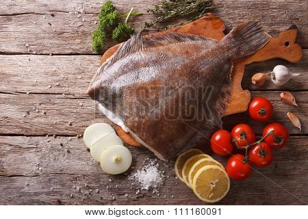 Raw Flounder With Ingredients On A Table. Horizontal Top View