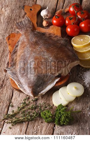 Raw Flounder With Ingredients On A Cutting Board Close-up. Vertical