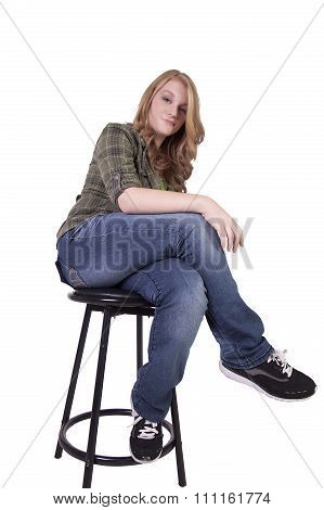 Girl On A Chair Posing