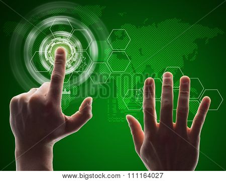Human hand pressing green virtual button