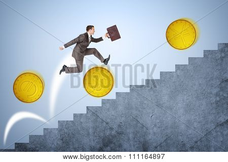 Businessman running up stairs with coins