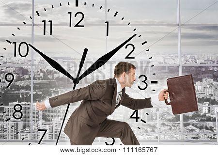 Businessman running with clock background