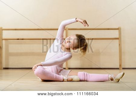 Little girl exercising on the floor