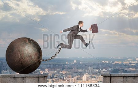 Image of young businessman jumping over gap
