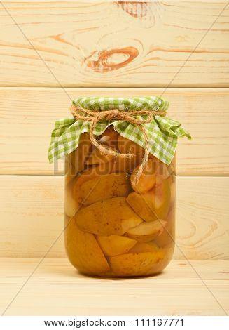 One Jar Of Pear Compote At Beige Vintage Wood Surface