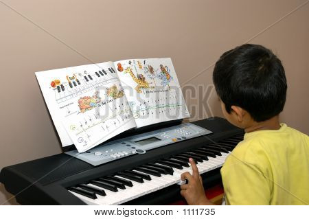 Kid Practicing Piano