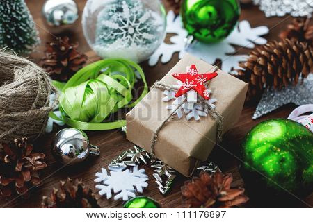 Christmas And New Year Background With Presents, Ribbons, Balls And Different Green Decorations