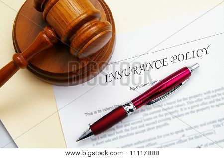insurance policy and gavel