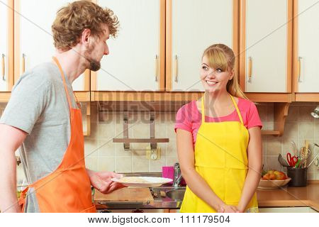 Happy Couple Woman And Man Cooking In Kitchen.