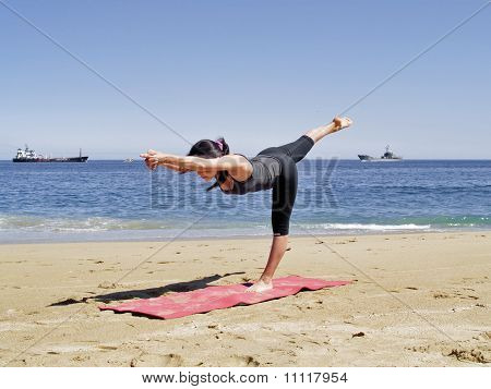 Bikram Yoga Tuladandasanal Pose At Beach