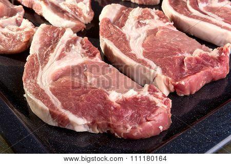 Chunks Of Fresh Pork Meat On A Baking Sheet