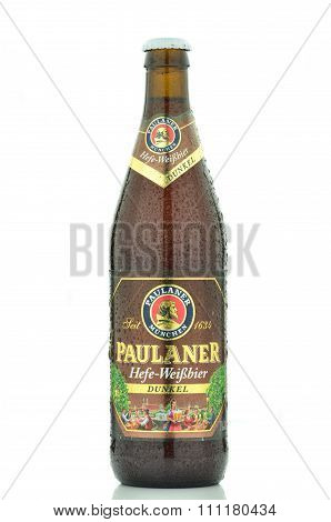 Paulaner dunkel beer isolated on white background