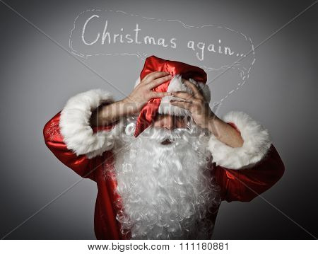 Frustrated Santa Claus. Concept - Christmas Again.