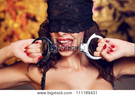 Sexy Woman Bite Handcuffs In Lace Eye Cover