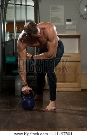 Man And Kettle Bell