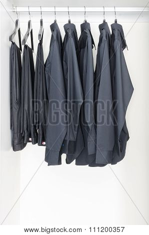 Black Clothes Hanging On Rail