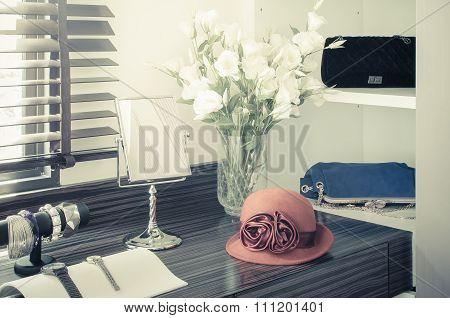 Orange Female Hat On Dressing Table
