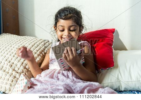 Indian girl unwrap with her gift box