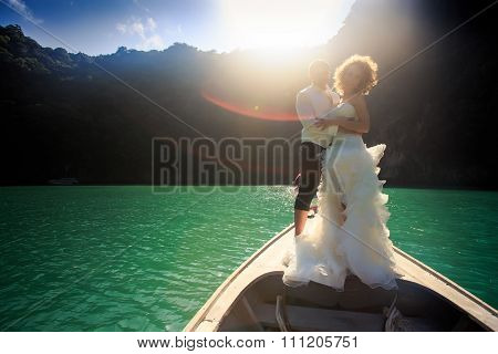 Backlight Groom Blonde Bride In Fluffy On Nose Of Longtail Boat