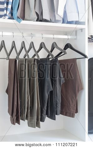 Pants Hanging On Rack In Wardrobe