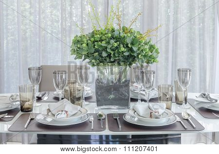 Plants In Glass Vase On Dinning Table