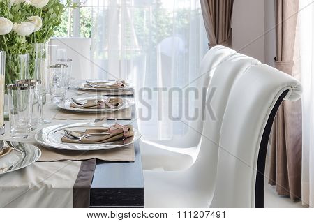 Table Set On Dark Brown Wooden Table In Dinning Room