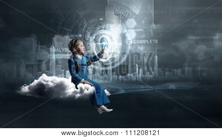 Little girl sitting on cloud and touching virtual panel with finger