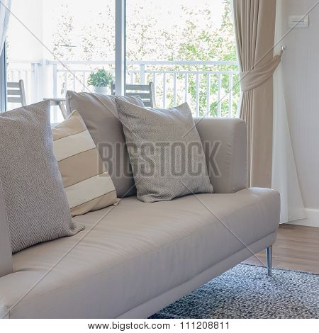 Earth Tone Color Sofa With Pillows In Modern Living Room