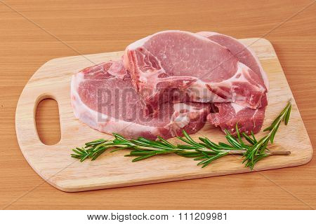 Pork Stake On A Chopping Board