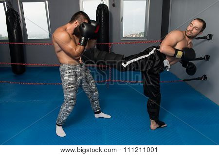 Two Boxers Facing Each Other In A Match