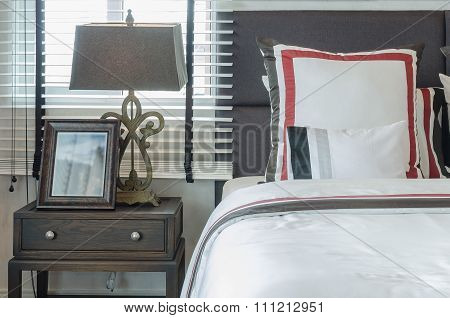 Classic Lamp Style With Wooden Picture Frame On Table Side