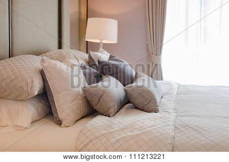 Luxury Bedroom With Pillows On Bed And White Classic Lamp