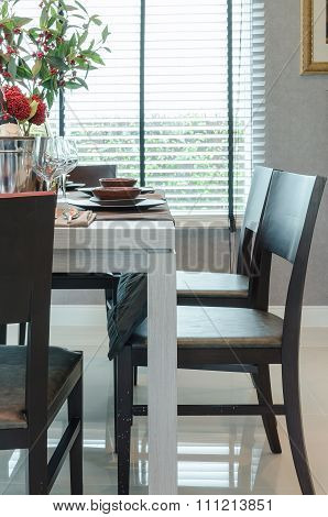 White Wooden Dinning Table With Dark Wooden Chairs