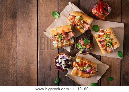 Hot Dog - Sandwich With Mexican Salsa On Wooden Background. Top View
