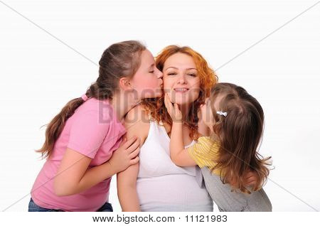 young pregnant mother and her two daughters