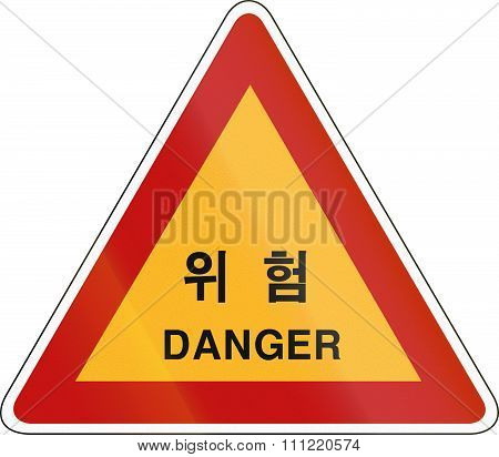 Korea Traffic Safety Sign With The Word Danger In Korean And Western Script