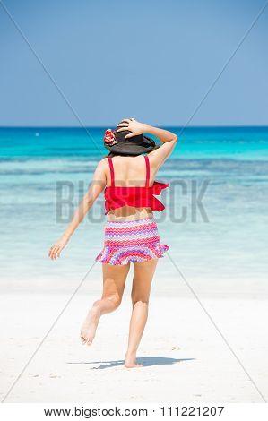 The girl on koh ta chai beach running down into the sea