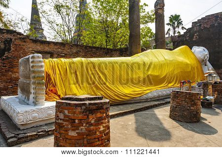 Lying Buddha Dressed In Yellow Scarf In Temple Wat Yai Chai-mongkol